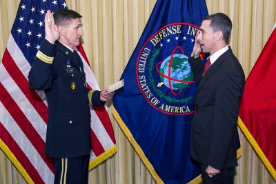 Lt. Gen. Michael Flynn, at left, swears Christopher Almont into the senior executive service ranks in May 2014.