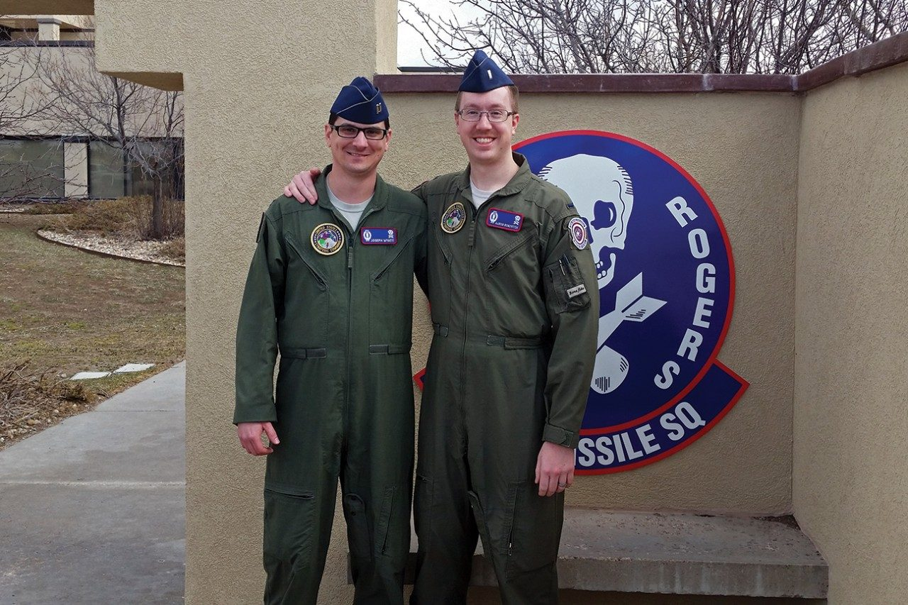 Aaron Bonovitch's first crew commander, Joe Wyatt, at left, poses for a picture with him after his last alert at F.E. Warren Air Force Base.