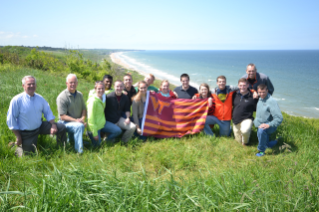 The 2016 VTCC Global Scholars at WN60 and the bluff overlooking Omaha Beach, site of 1st Lt. Jimmie Monteith's assault on June 6, 1944.