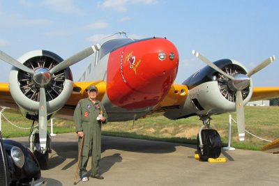 "Maj. Stanley Cohen in front of a 70-plus-year old C-45 aircraft named ""Hokie Pokie."" The university purchased the plane after World War II, and it is now owned by the Tri-State Warbird Museum of Batavia, Ohio."
