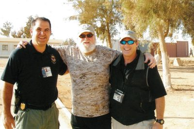 Taylor Jones, left, with Charlie Daniels, center, and another NCIS agent at Al Asad Air Base, Iraq, 2010.