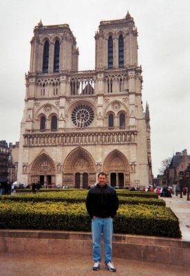 One of the perks of the job: Taylor Jones stands outside Notre Dame Cathedral in Paris, 2007.