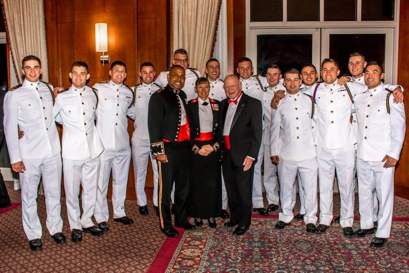 First Class Raider Company midshipmen pose for a picture during the Navy and Marine Corps Birthday Ball with Maj. Ahmad Martin, Col. Julie Nethercot, and Capt. Melvyn Huber (retired).