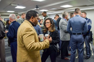 People mingle during the Coffee with the Corps event.