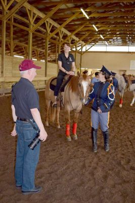 Pony rides were given during the end-of-year event. Cadet Fallon Fulgenzi '18 leads Alumni Director Col. Patience Larkin '87 on Sunny the horse while Commandant of Cadets Maj. Gen. Randal D. Fullhart observes.