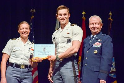 Spring Regimental Commander Cassandra Davis '17, at left, and Maj. Gen. Randal D. Fullhart, at right, award Golf Company Commander Nathan Sipantzi '17 the Beverly S. Parrish Award.