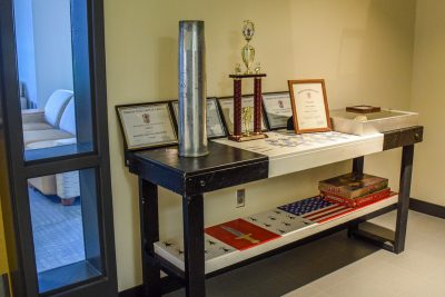 Lima Company offers a display of company memorabilia outside the fifth-floor study lounge of New Cadet Hall.