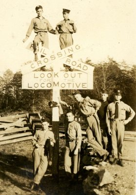 Cadets pose in a funny picture at a railroad crossing sign.