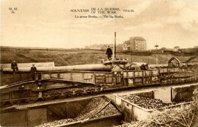 A postcard features the picture of a large piece of artillery.