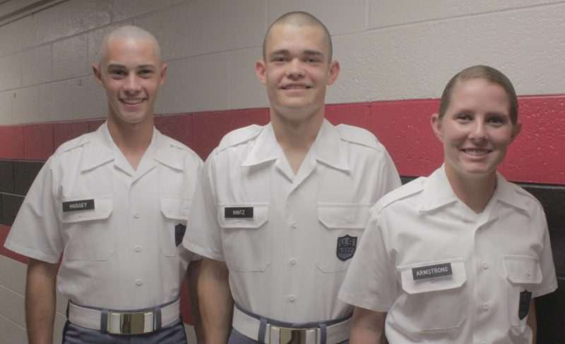 From left to right are Cadets Lawrence Hussey, Christopher Hintz, and Lisa Armstrong standing in Brodie Hall.