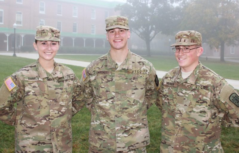 From left to right are Cadets Rachel Daniels, John Crockett, and Gregory Milhiser standing on the Upper Quad.