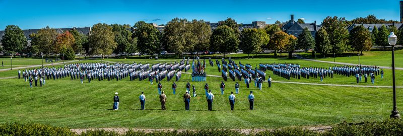 The regiment stands in formation on the Drillfield.