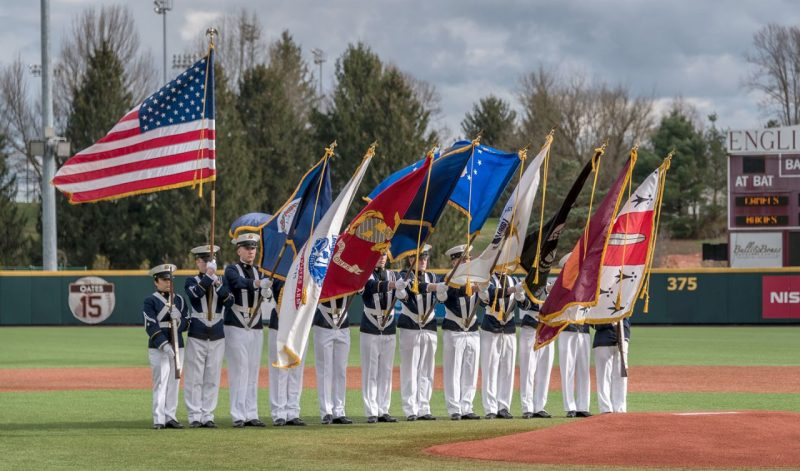 The Corps of Cadets' Color Guard carry the flags on English Field before a baseball game.