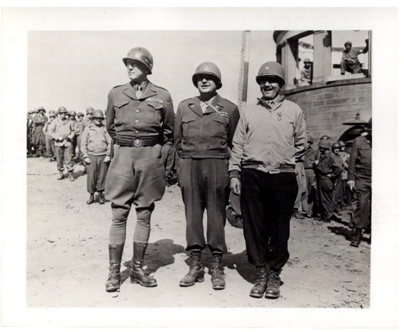 From left: Gen. George S. Patton, Maj. Gen. Cecil R. Moore, and unknown Army officer.