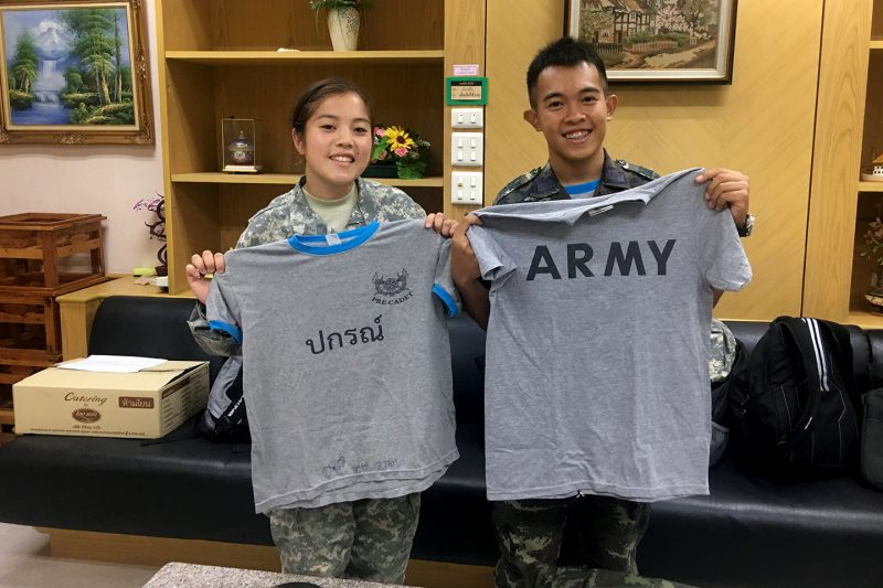 Cadet Liana Sinnott '18, at left, trades a T-shirt with a cadet from Thailand.