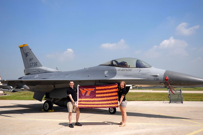 2nd Lt Allison (Laclede) Tillotson '15, and husband, 2nd Lt Ian Tillotson '14, stand in front of a F-16 Fighting Falcon at Kunsan Air Base, South Korea.