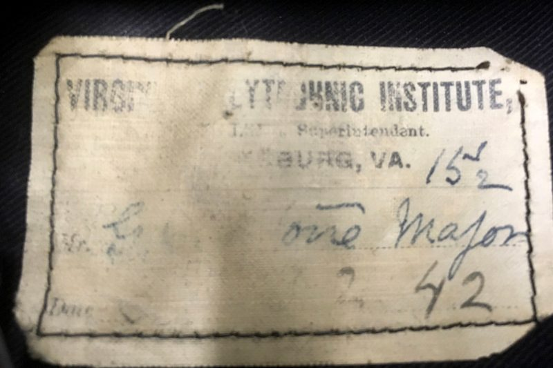 The name tag from a tattered example of the 1896 dress uniform.