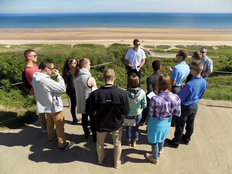 Cadet Nicholas Masella '18 leads a discussion at Omaha Beach.
