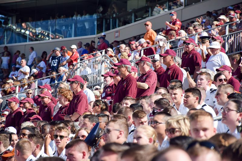 A group of alumni can be seen in the crowd in the stands of Lane Stadium.