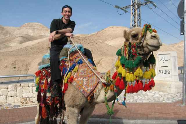 Christopher Almont rides a camel.