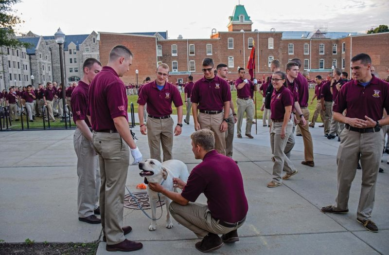 Cadet Zack Sever and Tank greet cadets after the first morning formation of the fall semester.