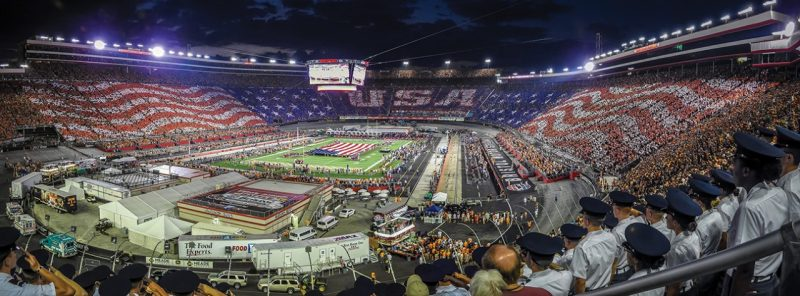 Cadets salute as the National Anthem is played at the Battle at Bristol football game.
