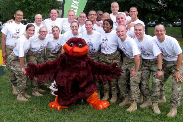 A large group of cadets poses with the HokieBird.
