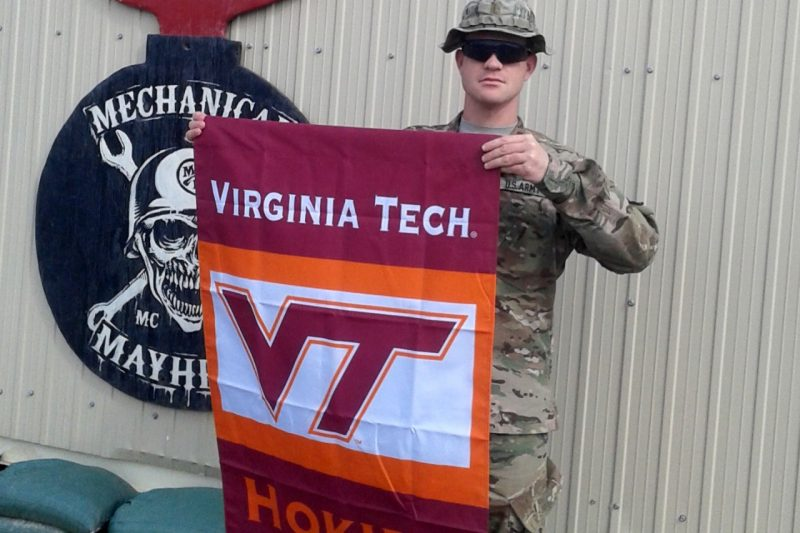 2nd Lt. Kevin T. McCann holds a Virginia Tech flag.