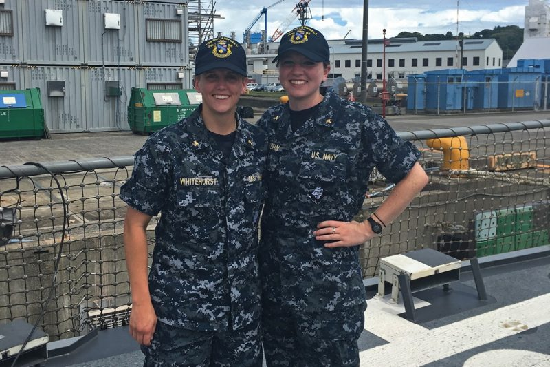 Midshipman Colleen McGovern '17, at right, with a midshipman from Virginia Military Institute aboard the USS McCampbell.