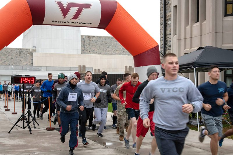 Runners leave the start line on Upper Quad during the Toughest Hokie competition on Oct. 28.