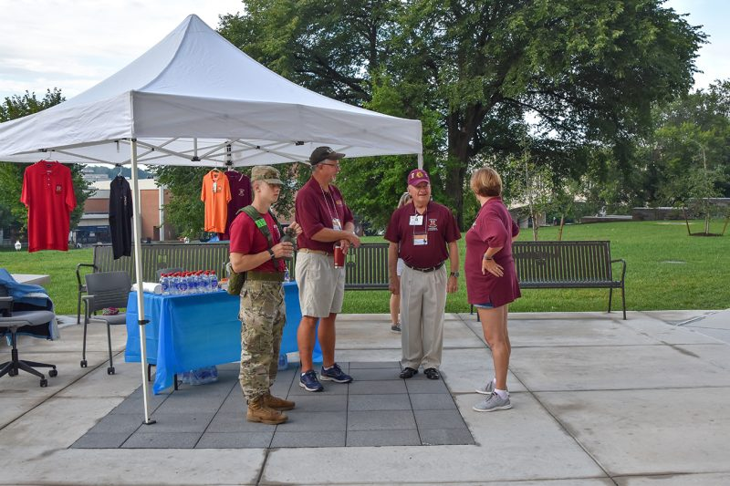 Alumni and friends of the Virginia Tech Corps of Cadets prepare to greet families during New Cadet Move-In on Aug. 11.