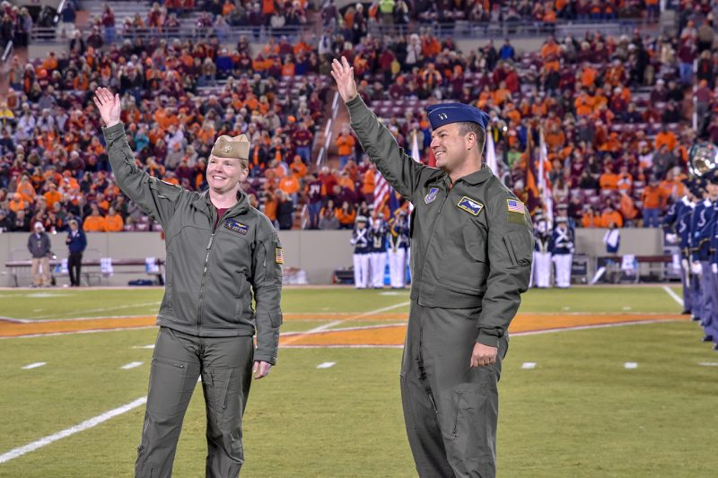 U.S. Air Force Capts. Lauren and Jimmy Callen '13 wave to the crowd at the Georgia Tech game on Oct. 25.