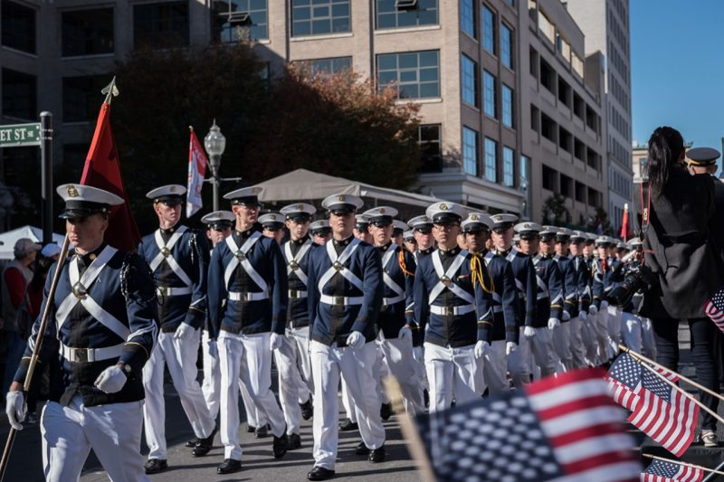 A company marches past the reviewing stand at the Virginia Veterans Parade.