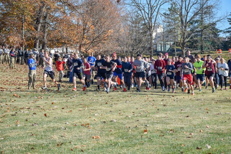 Runners take off from the start line of the Corps' Veterans 5K event on the Virginia Tech Cross Country Course.