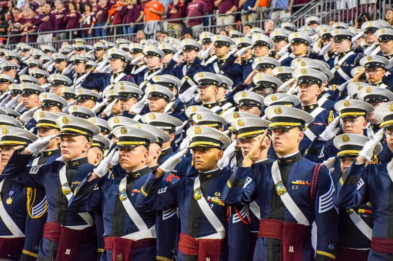 Cadets salute in the South End Zone of Lane Stadium.