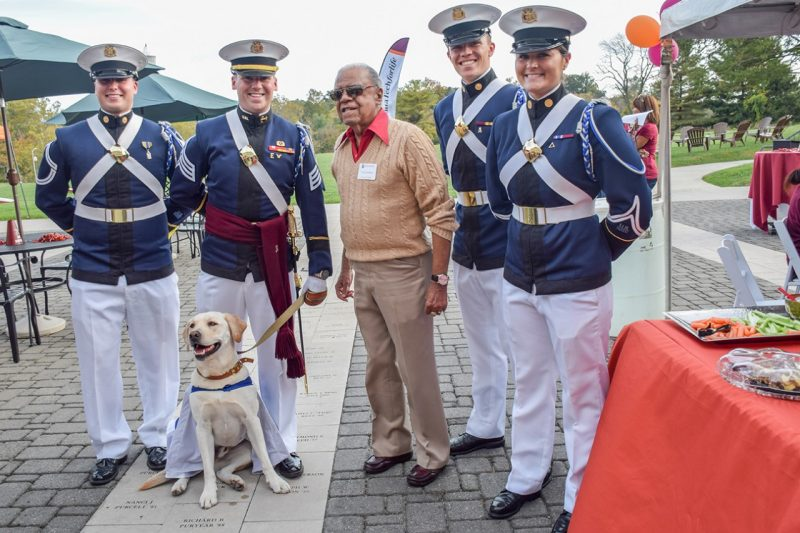 Growley and cadets pose for a picture with Irving Peddrew, at center.