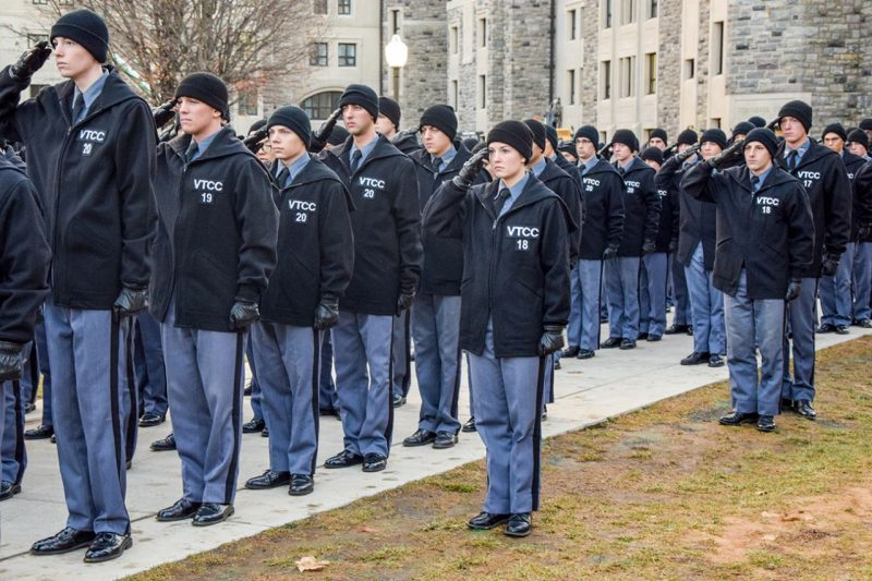 Cadets salute the colors during morning formation.