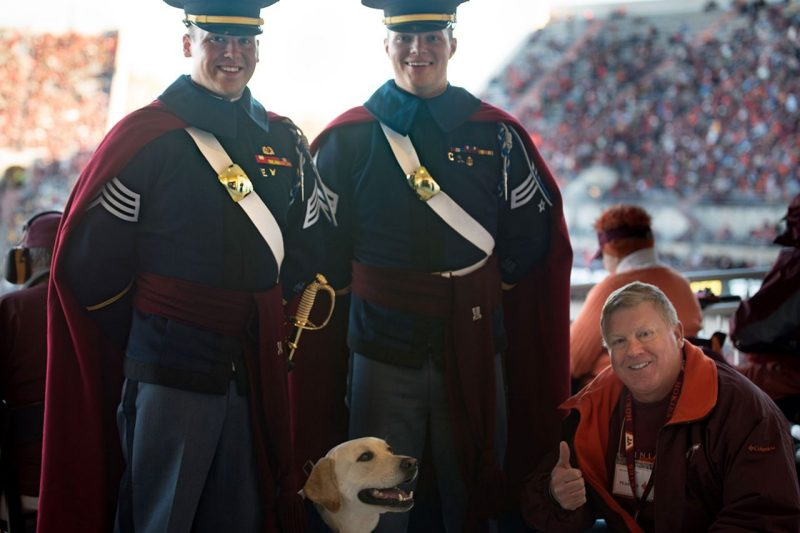 From left, cadet handlers Zack Sever '17, Je Zander '17, and Growley II catch up with J. Pearson on Worsham Field.
