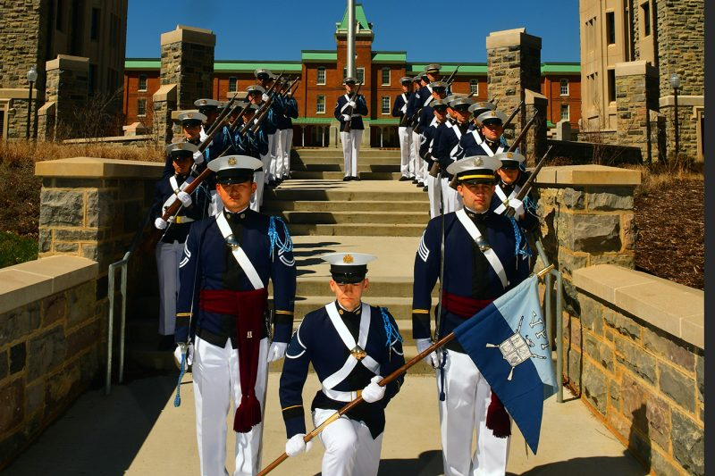 Members of the Gregory Guard pose in formation outside Lane Hall.