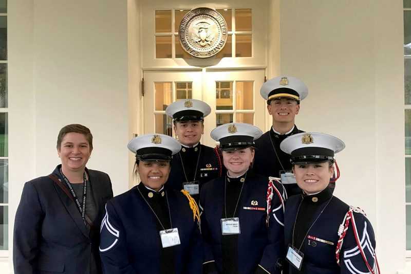 Kristen Meister '07, at left,  with a group of cadets.