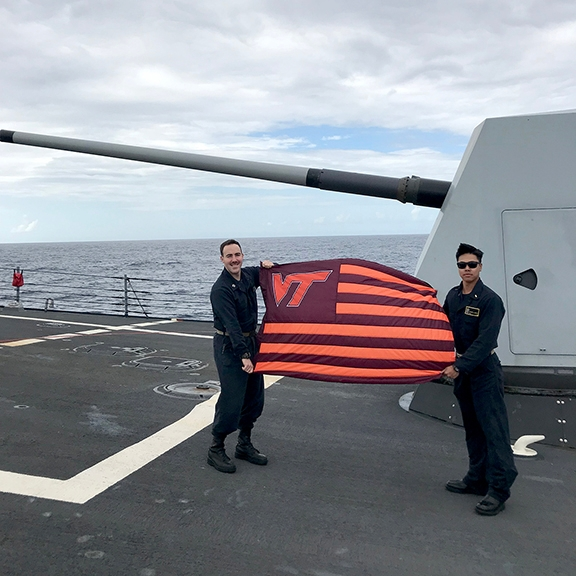 Lt. Ethan Yelverton '13, at left, and Ensign Leland Remias VT'17 aboard the USS Forrest Sherman.