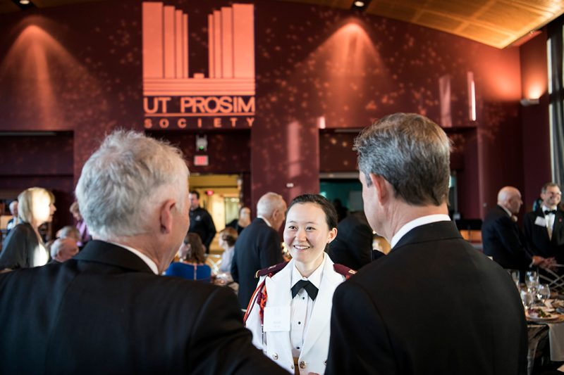 Cadet Annie Ha '19 talks with guests.