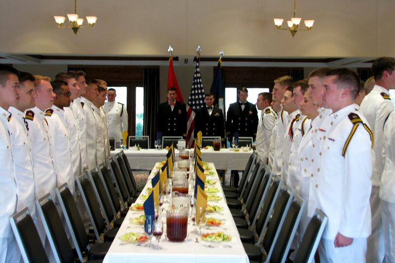 Midshipmen enter the German Club Manor at Virginia Tech to begin Senior Dining-In.