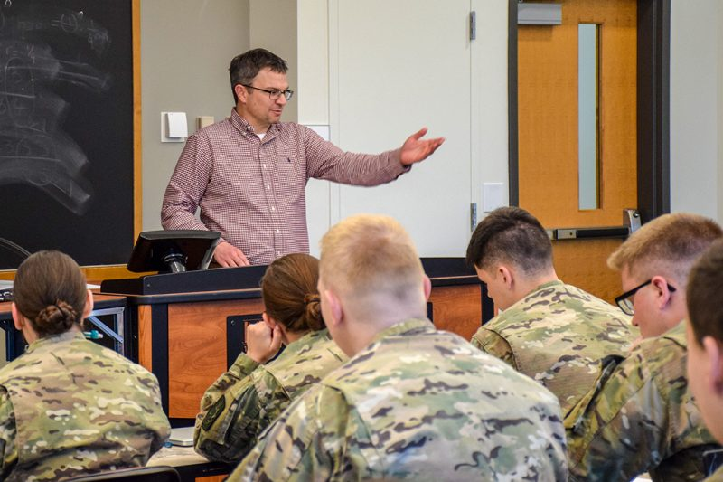 Stuart Meese lectures in a classroom of cadets.