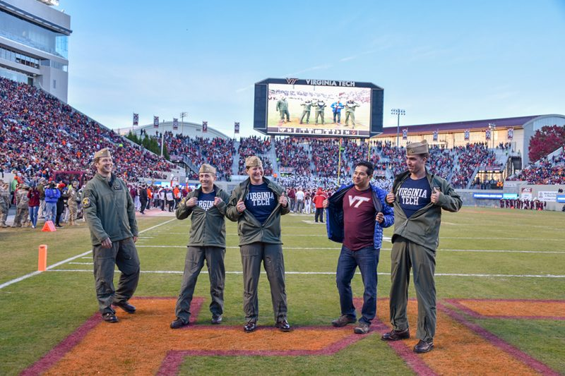 A crew from Strike Fighter Squadron 32 are recognized in Lane Stadium after performing a flyover at the 2019 homecoming game.