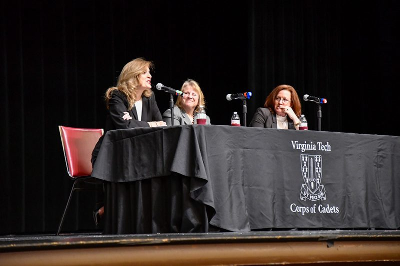 From left: Jeannine James '87, Jill Boward '87 and Christy Nolta '85 talk while seated on a stage.