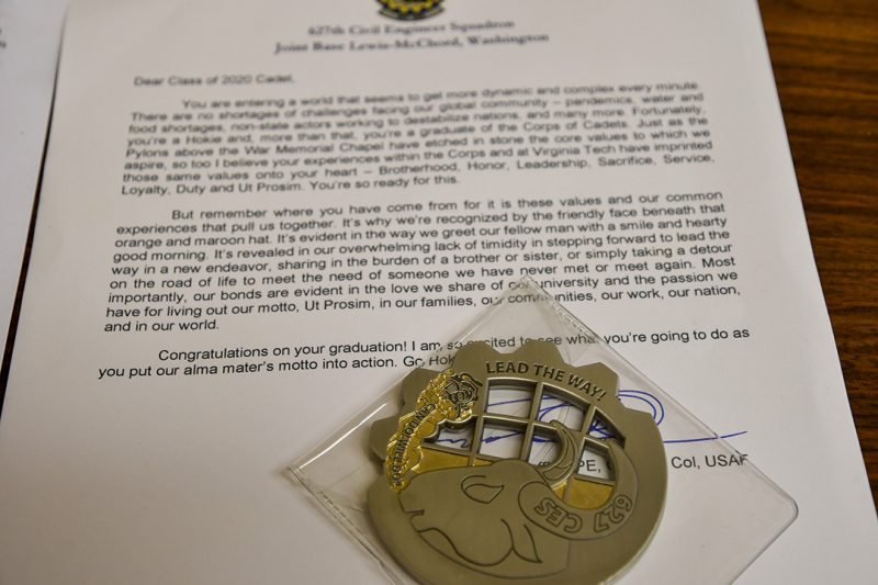 A letter to a cadet includes a uniquely shaped challenge coin.