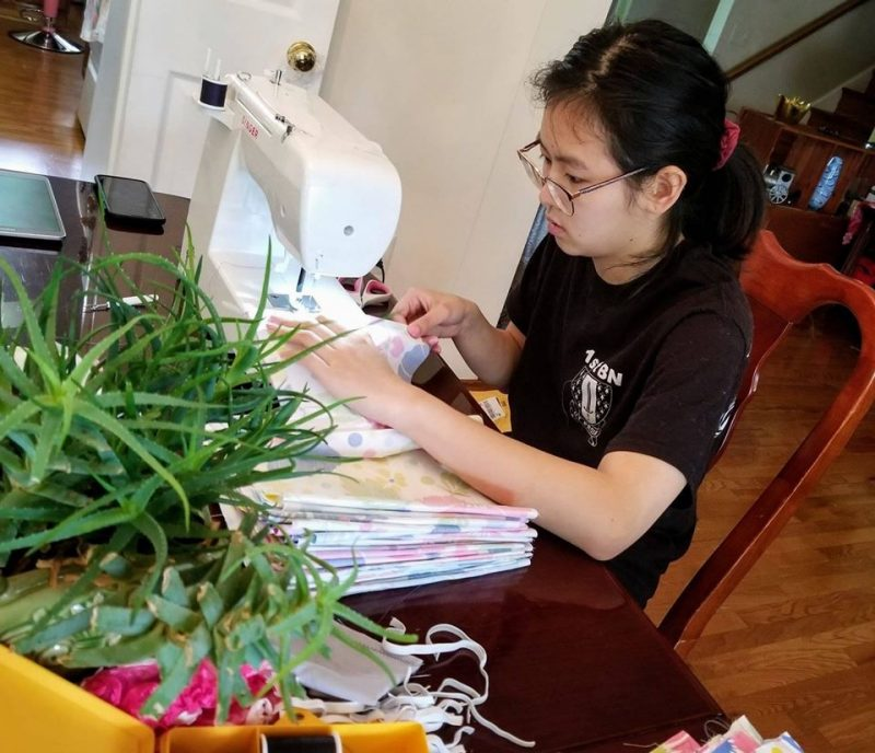 While taking her classes at home, Cadet Vivian To '23 sews face masks to donate