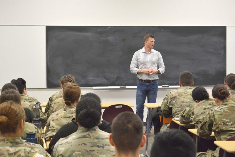Joe McNamara '07 speaks to a classroom filled with cadets.