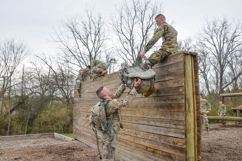 Cadets work together on the obstacle course.